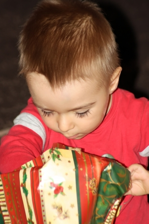 Little child what is looking for his Christmas gift photo