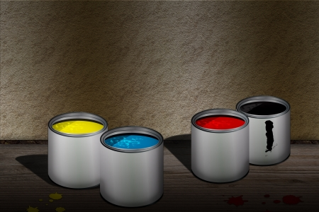 CMYK cans of paint over wooden floor photo