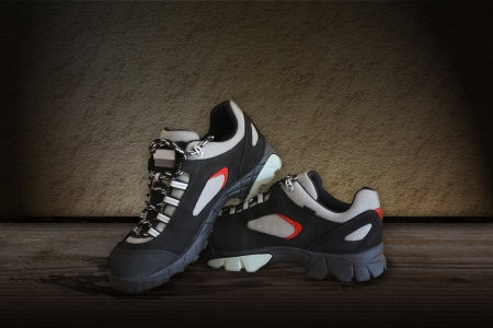 All terrain pair shoes over the wooden floor Stock Photo - 17308168