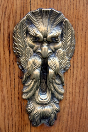 Medieval bronze knocker on the wooden door from Bologna, Italy Stock Photo - 17580188