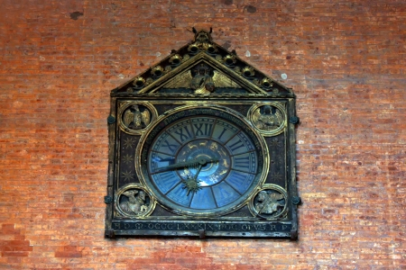 Antique clock on bricks wall from Bologna Stock Photo - 17580235