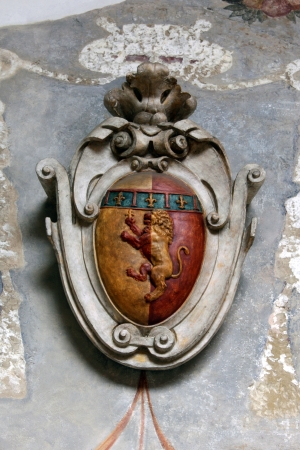 Ancient coat of arms on exterior house wall from Bologna, Italy Stock Photo - 17580192