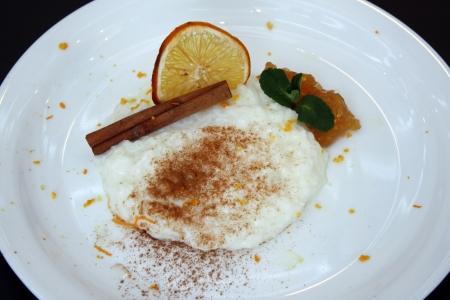 Closeup scene of rissoto dessert with gem and cinnamon Stock Photo - 17698764