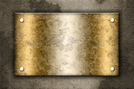 Golden plate over concrete wall photo