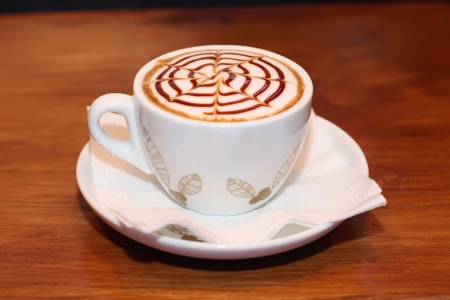 Cappuccino coffee with chocolate on top at bar photo