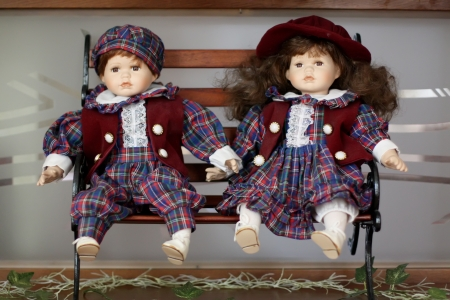 Dolls - Boy and girl together in park photo