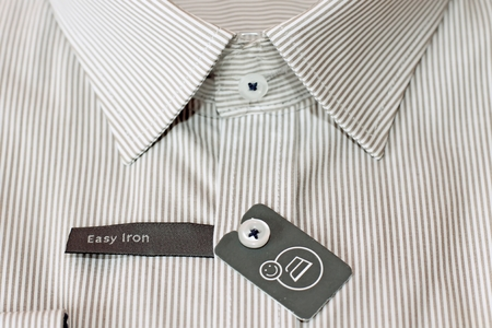 New shirt with label on button photo