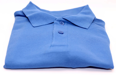 elastic garments: Blue t shirt over white background