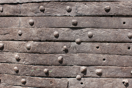 upholstered: Metallic upholstered surface of medieval door Stock Photo