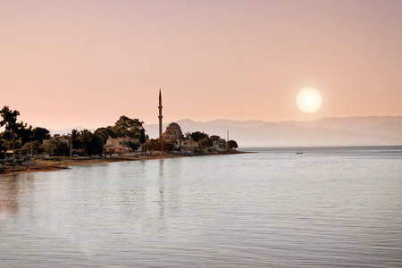 islamic wonderful: Mosque with reflection on sea water Stock Photo