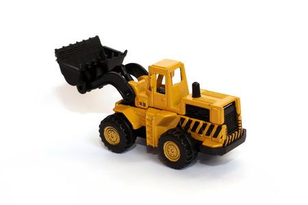 plastic scoop: Toy bulldozer isolated over white background Stock Photo