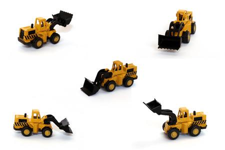 Bulldozer toys over white background photo
