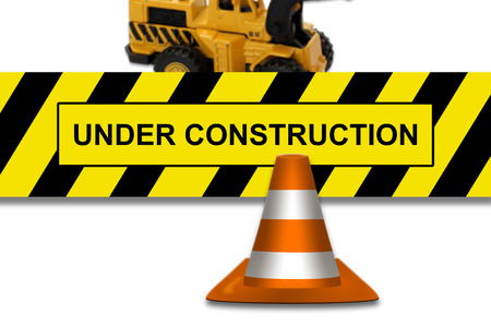 Under construction signboard with traffic cone photo