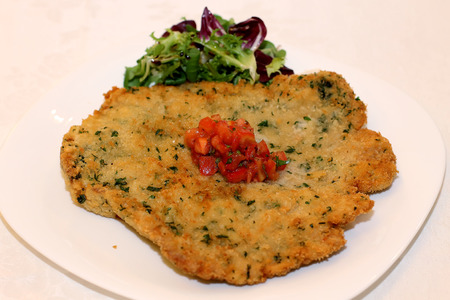 schnitzel: Pork Schnitzel on white plate at restaurant Stock Photo