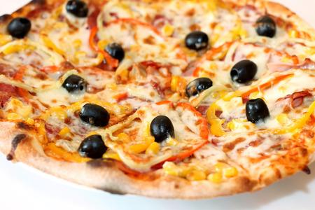 Closeup scene of pizza over white plate photo