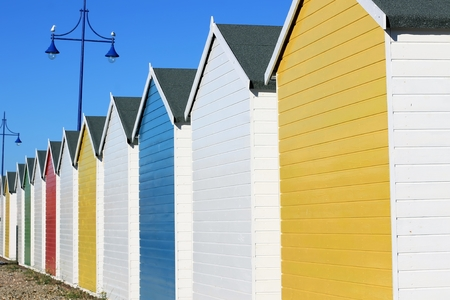Row of colourful chalets in Eastbourne