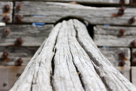 Old wood girder, part of a wood fence