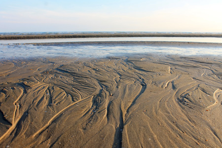 Retreat sea at Camber Sands beach Stock Photo
