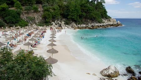 THASSOS, GREECE, Marble beach  Saliara beach , Thassos, Greece tourists enjoying a nice summer day at the beach  photo