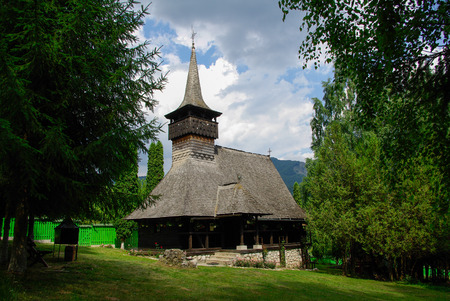Traditional wood church from Romania  Romanian traditional architectural style, life in the countryside  Wood church monastery Dragoslavele  photo