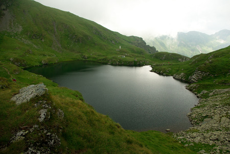 Capra lake  Goat lake  in the Transylvanian Alps, Romania photo