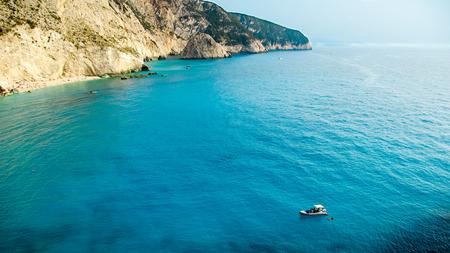Small yacht anchored at Porto Katsiki beach on Lefkada island, Greece. Beautiful view of Porto Katsiki beach at Lefkada island, Greece. Beautiful view of Porto Katsiki beach at Lefkada island, Greece photo