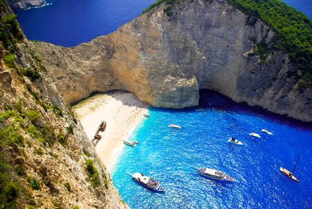 Navagio Beach - Shipwreck Beach, Zakynthos Island, Greece. Aerial view of the most beautiful beach in Zakynthos island - Navagio with shipwreck, Greece, Ionian islands Фото со стока