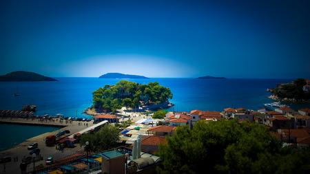 Skiathos town in Skiathos Island, Greece. Skiathos Island is located in the northern part of Sporades islands group. The main towns are the Town of Skiathos, it is located to the northeast next to a lagoon. photo