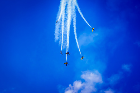 aerobatic: Airplanes on airshow. Aerobatic team performs flight