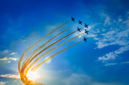 Airplanes on airshow. Aerobatic team performs flight