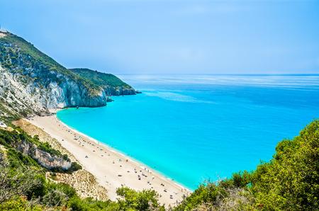 Milos beach on Lefkada island, Greece. Milos beach near the Agios Nikitas village on Lefkada, Greece. People relaxing at the beach