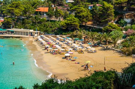 cefallonia: Platis Gialos and Makris Gialos Beach, Kefalonia island, Greece.  PLATIS GIALOS AND MAKRIS GIALOS BEACH, KEFALONIA ISLAND, GREECE - JULY 10, 2015: People relaxing at the beach. Editorial
