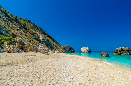 ionian island: Megali Petra Beach, Lefkada Island, Levkas, Lefkas, Ionian sea. Wild beach of Megali Petra. A beautiful beach with large rocks in the water.