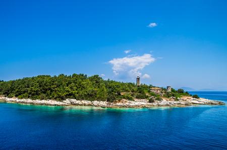 cefalonia: Greek llighthouse at the island Kefalonia, Ionian Islands. Old Venetian lighthouse of Port Fiskardo on Kefalonia island, Greece.