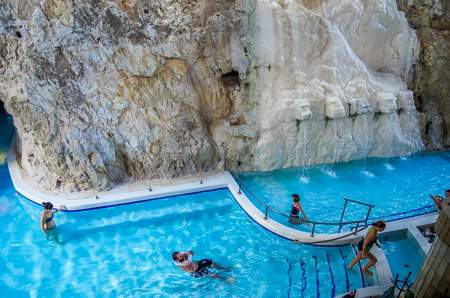MISKOLC, HUNGARY - NOV 30, 2015: Unidentified people relaxing in a pool in Barlangfurdo, a thermal bath complex inside of a natural cave in Miskolctapolca town.