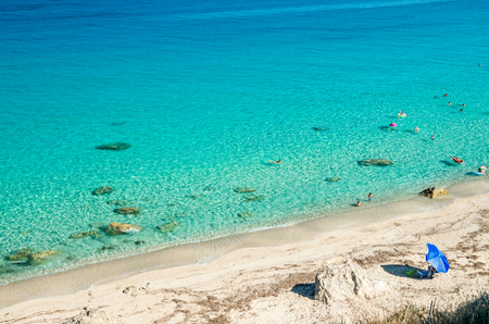 ionian island: Agios Nikitas beach in Lefkada Island, Greece - Ionian Islands. In the background it is visible the village of Agios Nikitas. The beach is near the village of Agios Nikitas.