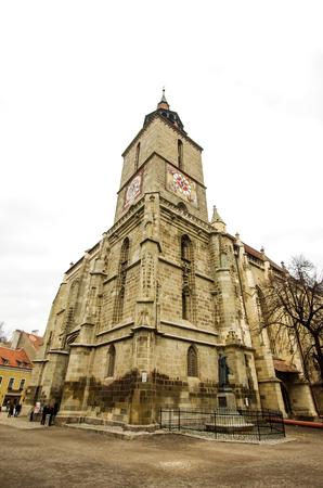 high priest: Black Church in Brasov, Romania. Black Church is a famous medieval church in Transylvania. Stock Photo