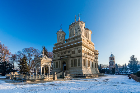 legend: Curtea de Arges monastery in winter, Romania. Curtea de Arges Monastery is known because of the legend of architect master Manole. It is a landmark in Wallachia, medieval Romania.