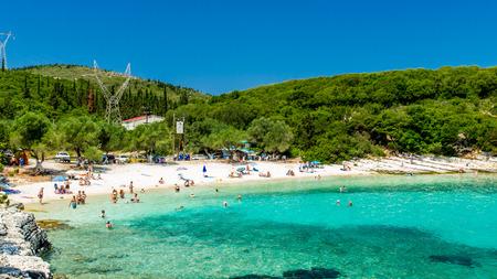 cefalonia: EMBLISI BEACH, KEFALONIA ISLAND, GREECE, JULY 12, 2015: People relaxing at the beach. Emblisi Beach, Kefalonia Island, Greece