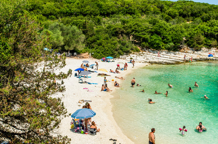 cefallonia: EMBLISI BEACH, KEFALONIA ISLAND, GREECE, JULY 12, 2015: People relaxing at the beach. Emblisi Beach, Kefalonia Island, Greece