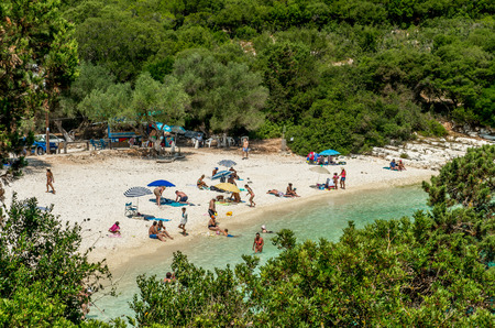 cefallonia: EMBLISI BEACH, KEFALONIA ISLAND, GREECE, JULY 12, 2015: People relaxing at the beach. Emblisi Beach, Kefalonia Island, Greece