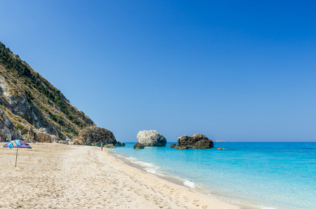 ionian island: Wild beach of Megali Petra. A beautiful beach with large rocks in the water. Megali Petra Beach, Lefkada Island, Levkas, Lefkas, Ionian sea,
