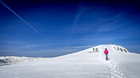 ridges: Winter landscape in the mountains. Group of hikers. Mountain ridges covered by snow in winter in Europe.