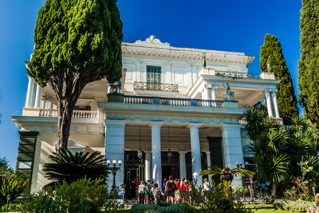 buit in: ACHILLEION PALACE, CORFU ISLAND, GREECE - August 8, 2014: People visiting the palace. It was buit by Empress of Austria, Elisabeth of Bavaria, also known as Sisi in 1890.