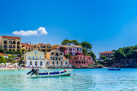 kefallonia: ASSOS TOWN, KEFALONIA ISLAND, GREECE - JULY 12, 2015: Bay of Assos with boats and yachts.