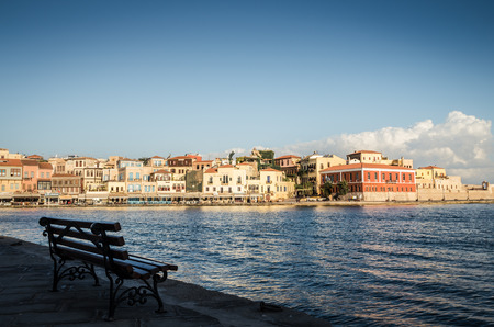 kreta: Chania town in Crete island. View of the old venetian port of Chania on Crete island, Greece. Tourists relaxing on promenade.