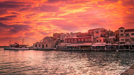 kreta: Stunning sunset view of the old venetian port of Chania on Crete island Greece. Stock Photo