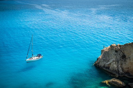 Porto Katsiki beach in Lefkada island, Greece. Luxury yacht on a blue sea.