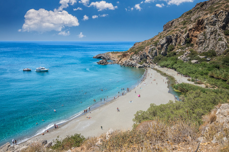 Preveli Beach in Crete island, Greece.  There is a palm forest and a river inside the gorge near this beach. Stock Photo