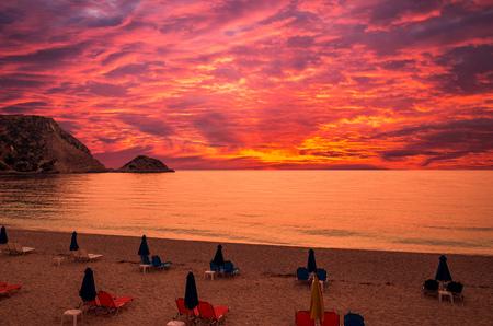 Sunset over Petani beach, Kefalonia island, Greece. View of Petani bay and beautiful beach, Kefalonia island, Greece. Stock Photo